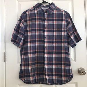 Striped button up shirt.